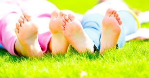 Child's foot on the grass Royalty Free Stock Photo