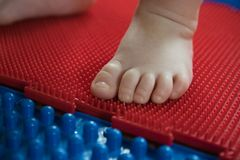 Child& x27;s foot on a yoga mat stock images
