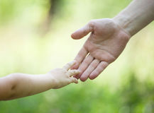Child's and gather's hands holding together Royalty Free Stock Images
