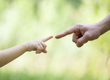 Child's and gather's hands indicating to each other Royalty Free Stock Photos