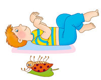 Child's gymnastics. The boy lying on a back, waves hands, as a bug who lies nearby Stock Photo