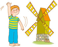 Child's gymnastics. The boy waves hands, as a windmill Stock Image