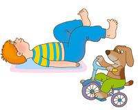 Child's gymnastics. The boy lying on a back, waves feet, representing driving on a bicycle Royalty Free Stock Images