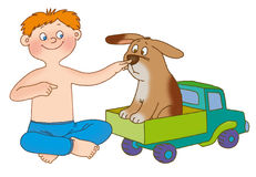 Child's gymnastics. The boy, sitting near to toy truck, presses on a nose to a puppy and on the breast, representing a car signal Stock Images