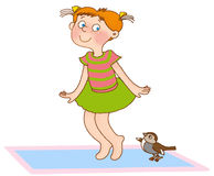 Child's gymnastics. Little girl jumps like a sparrow on a gymnastic mat Stock Photo