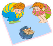 Child's gymnastics. Little boy and a girl pretend to be curled hedgehogs Stock Images
