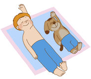 Child's gymnastics. Boy and dog lying on his back, doing gymnastics, placing his hands behind his head Royalty Free Stock Image