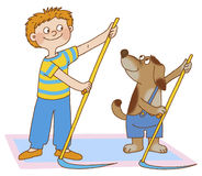 Child's gymnastics. Boy and dog are doing gymnastic exercises, as if they mow the grass Royalty Free Stock Images