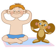 Child's gymnastics. Boy does massage the ears, depicting toy Stock Image