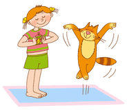 Child's gymnastics. Little girl and cat shows birds flying Stock Images