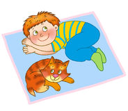 Child's gymnastics. Little boy and kitten are lying on a mat Stock Images