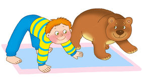 Child's gymnastics. Little boy and bear cub are on a mat on a white background Royalty Free Stock Images