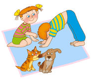 Child's gymnastics. Little girl,boy,kitten and puppy are playing on a mat on a white background Royalty Free Stock Image