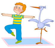 Child's gymnastics. Little boy and stork are on a mat on a white background Stock Photography