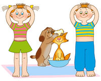 Child's gymnastics. Little girl,boy,kitten and puppy are washing Royalty Free Stock Images