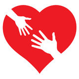 Child's Hand and Adult Hand on heart Royalty Free Stock Image