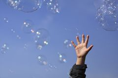 Child's Hand and Bubbles Royalty Free Stock Photo