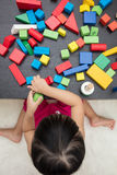 Child`s hand close up playing building blocks Stock Photo