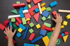 Child`s hand close up playing building blocks Royalty Free Stock Photo