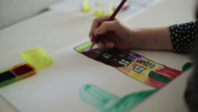 A child's hand coloring with a pencil. Slow motion. stock video footage
