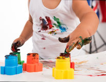 Child's hand and colors Royalty Free Stock Photography
