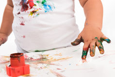 Child's hand and colors Royalty Free Stock Images