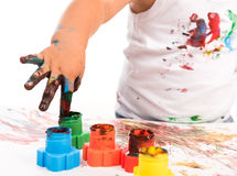 Child's hand and colors Royalty Free Stock Photo