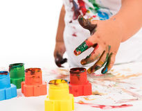 Child's hand and colors Royalty Free Stock Photos