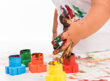 Child's hand and colors Stock Images