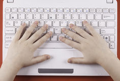 The child's hand on computer keyboard top view closeup Stock Images
