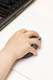 Child's Hand with Computer Mouse. Photo of child's hand with computer mouse Royalty Free Stock Photo