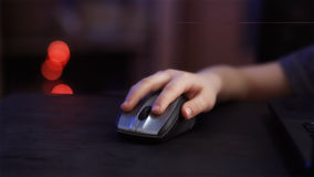 Child`s hand with computer mouse Royalty Free Stock Images