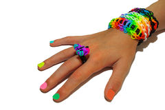 A child's hand decorated with rubber bands loom Royalty Free Stock Image
