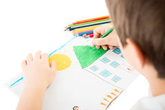 Child's hand drawing. Child drawing a home with pencil royalty free stock image