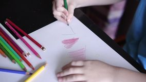 child`s hand drawing green pencil heart stock video footage