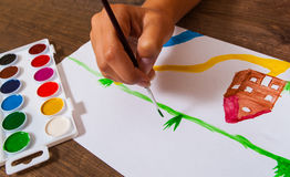 The child`s hand draws a picture Royalty Free Stock Image