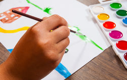 The child`s hand draws a picture Royalty Free Stock Photos