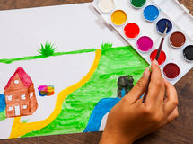 The child`s hand draws a picture Royalty Free Stock Images