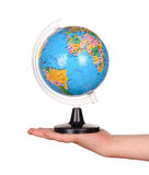 Child's hand holding a globe Stock Photo