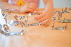 Child`s hand holding a mold is learning to make a cake royalty free stock photo