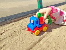 child& x27;s hand holding a toy car. Sunny warm day. Child play with toy car royalty free stock photos