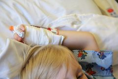 Child's Hand With I.V. in it at Hospital Stock Photo