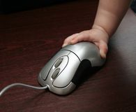 Child's hand and mouse. And guiding Stock Image