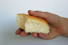 Child`s hand offering or holding a piece of bread stock images