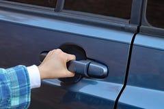 Child& x27;s hand opening vehicle door handle stock photography