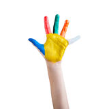Child's hand painted with multicolored finger paints Royalty Free Stock Photo