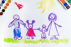 Child`s hand paints sketch of the family Stock Photos