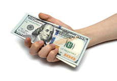 Child's hand and pile new cash U.S. dollars Royalty Free Stock Photos