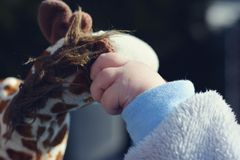 Child's hand playing on toy Royalty Free Stock Photo