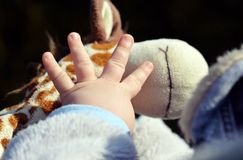 Child's hand playing on toy Stock Photo